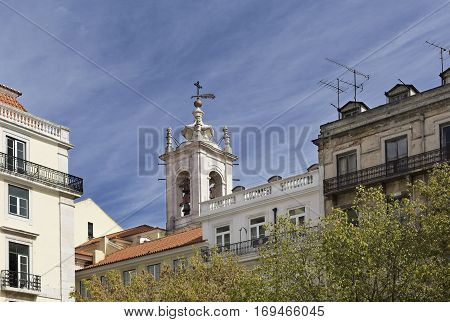 View of the bell tower of the Basilica of the Martyrs in the old quarters of Lisbon Portugal