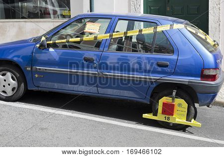 LISBON, PORTUGAL - September 26, 2016: A wheel clamp parking ticket in Lisbon Portugal