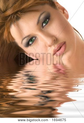 Beautiful Redheaded Woman Face Reflected In Water