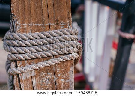 Posts rope around, mooring boats close up
