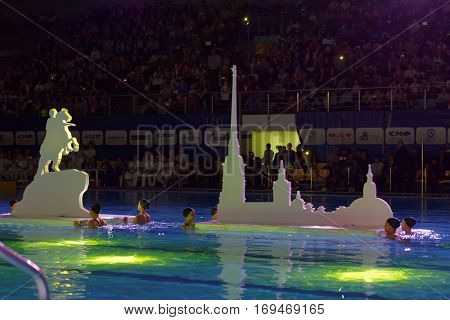 ST. PETERSBURG, RUSSIA - DECEMBER 16, 2016: Water show during the opening ceremony of X Vladimir Salnikov Cup. Athletes from 6 countries participated in the competitions