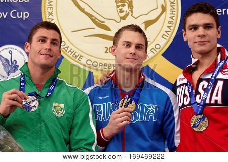 ST. PETERSBURG, RUSSIA - DECEMBER 17, 2016: Winners of X Salnikov Cup in 50 m freestyle swimming Vladimir Morozov of Russia (center), Douglas Erasmus of RSA (left) and Evgeny Rylov of Russia