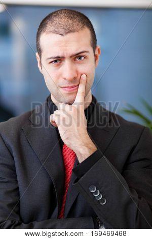 Doubtful businessman portrait