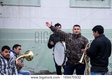 ZRENJANIN SERBIA - FEBRUARY 28 2015: Roma music band rehearsing before a wedding performance