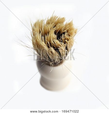 Shaving brush with real bristles on white background