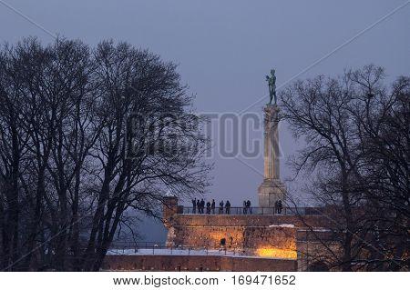 Victor  (Pobednik) statue on Kalemegdan fortress at sunset in winter - Belgrade - Serbia poster