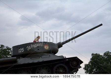 TIRASPOL TRANSNITRIA (MOLDOVA) - AUGUST 12 2016: Little Girl playing on Tank Monument erected to commemorate 1992 Transnitria civil war. Transnistria (also called Trans-Dniestr or Transdniestria) is a small breakaway state located between Moldova & Ukrain