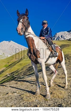 Boy And His Horse In Kyrgyzstan