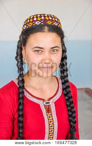 Woman With Long Braids Of Hair In Turkmenistan