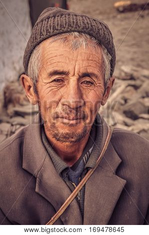 Man With Grey Cap In Tajikistan