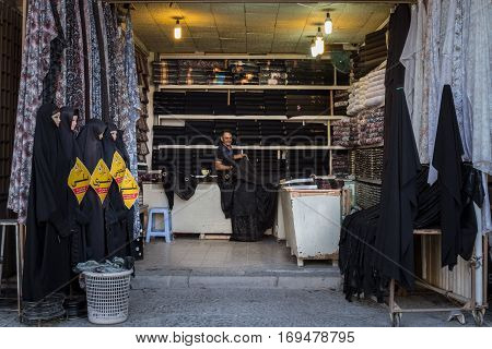 ISFAHAN IRAN - AUGUST 20 2016: Islamic outfit seller (hijab veils and scarfs) in Isfahan bazaar