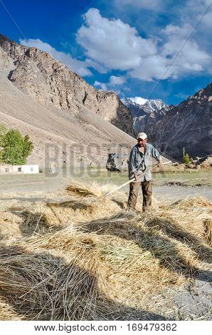 Native Man With Hayfork In Tajikistan