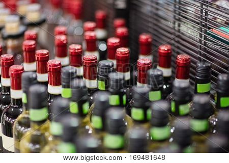 Close up of red and white wine bottles on a grocery