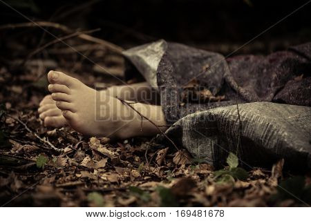 Bare Feet Of Human Corpse In Forest