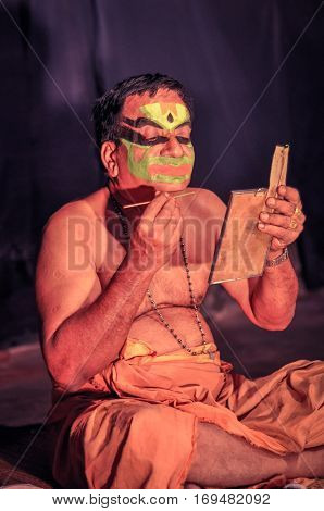 Sitting Man With Colours In Kerala