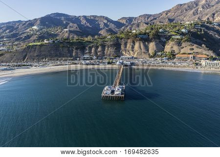 Aerial of Malibu Pier State Park and the Santa Monica Mountains near of Los Angeles California.