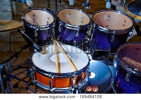 Drums set and sticks close-up, part of the drum kit