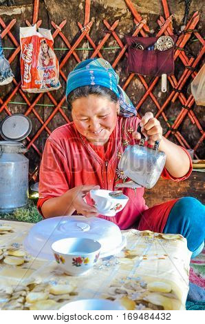 Woman With Tea In Kyrgyzstan