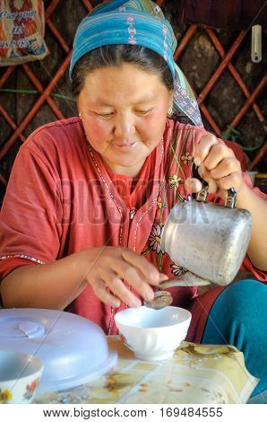 Woman With Tea Pot In Kyrgyzstan