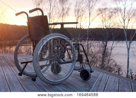 Empty wheelchair standing in a park
