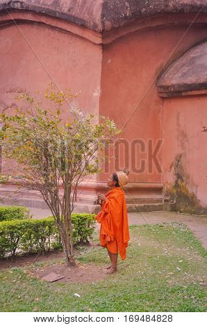 Woman In Orange In Assam