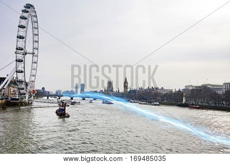 Blue streak of light passing over river Thames