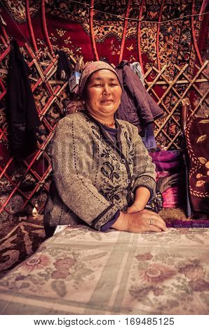 Native Woman With Headcloth In Kyrgyzstan
