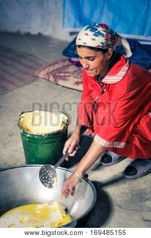Woman With Butter In Tajikistan