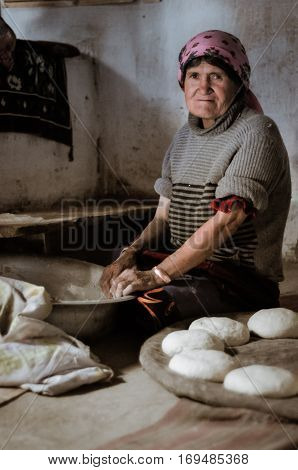 Woman Preparing Bread In Tajikistan
