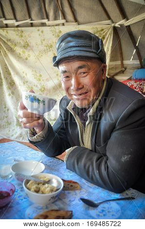 Man With Leather Cap In Kyrgyzstan