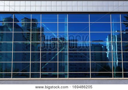 Facade of modern building. Abstract blue architectural background.