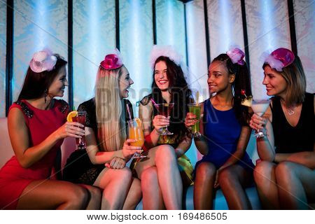 Group of friends sitting together and having mocktail at bar