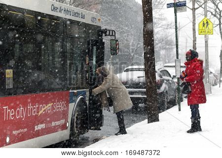 BRONX NEW YORK - JANUARY 7: Woman boarding bus during snow storm. Taken January 7 2017 in New York.