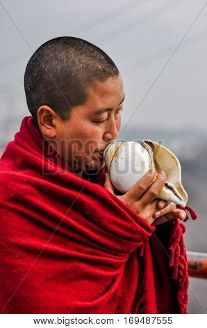 Monk With Seashell In Arunachal Pradesh