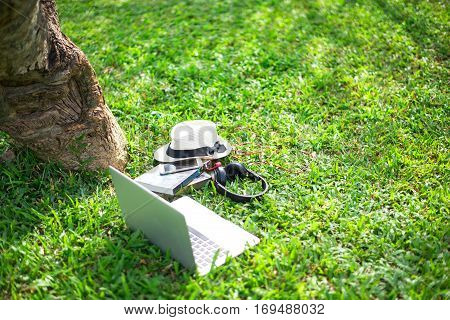 Enjoy listening music on the grass field of the park in the morning greenery tone 2017