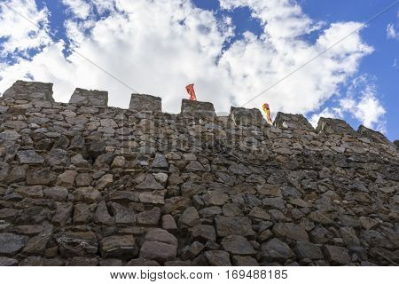 Defense, Stone walls of a medieval castle. Town of Consuegra in the province of Toledo, Spain