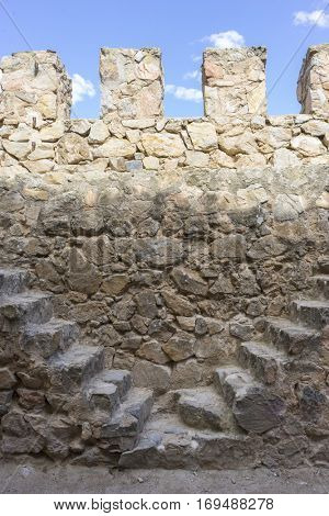 Firewall, Stone walls of a medieval castle. Town of Consuegra in the province of Toledo, Spain
