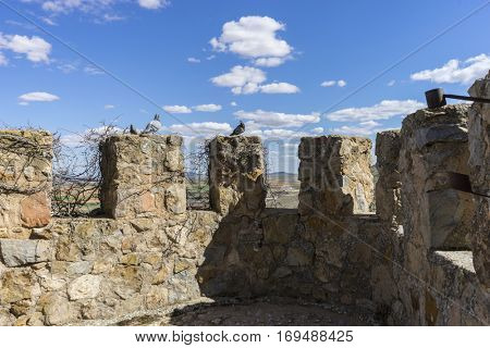 Details of battlements of a medieval castle. Town of Consuegra in the province of Toledo, Spain
