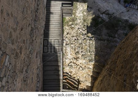Wooden stairs in a medieval castle. Town of Consuegra in the province of Toledo, Spain