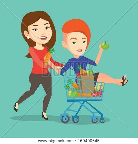 Happy caucasian woman pushing a shopping trolley with her friend. Couple of young carefree friends having fun while riding by shopping trolley. Vector flat design illustration. Square layout.