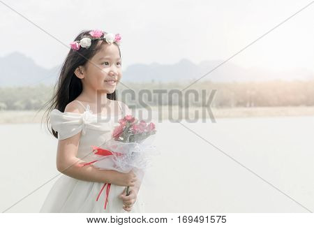 Cute Little Bride Hold Rose Bouquet On Nature Background