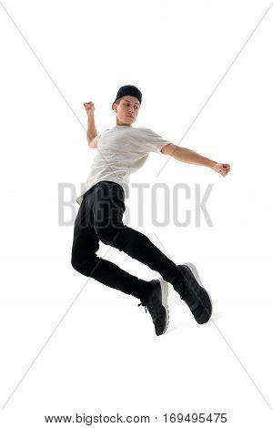 Full length vertical shot of young male hip-hop dancer performing on white isolated studio background