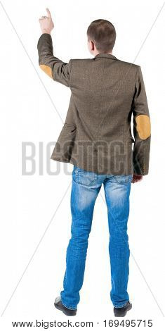 Back view of pointing business man. gesticulating young guy in jeans and suit jacket with patches on the sleeves. Rear view people collection.  backside view of person.  Isolated over white background