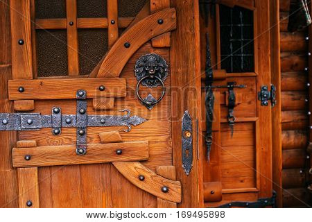 wooden door with metal forging old stuff
