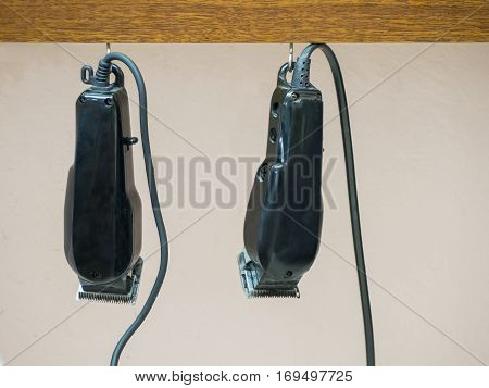 two hair clipper equipment  for barber hanging