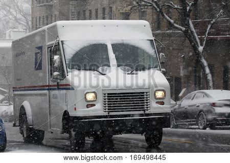 BRONX NEW YORK -JANUARY 7: United States Postal Service truck in snow storm. Taken January 7 2017 in New York.