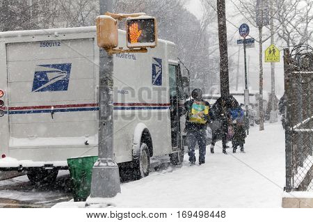 BRONX NEW YORK -JANUARY 7: Mail man delivers mail in snow storm. Taken January 7 2017 in New York.