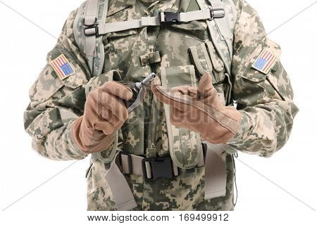 Close up view of soldier with fragmentation grenade on white background