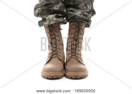 Feet of soldier on white background, close up