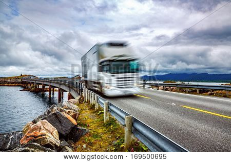 Truck and highway at sunset. Truck Car in motion blur. Atlantic Ocean Road or the Atlantic Road (Atlanterhavsveien) been awarded the title as